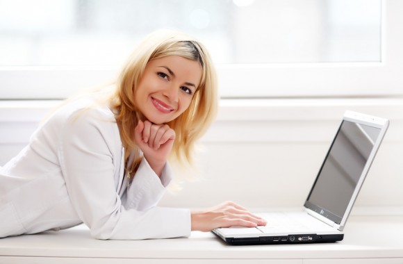 Beautiful business lady typing on a laptop computer.
